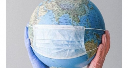 Image of hands holding globe