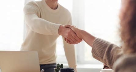 Interview applicant shaking hands with employer