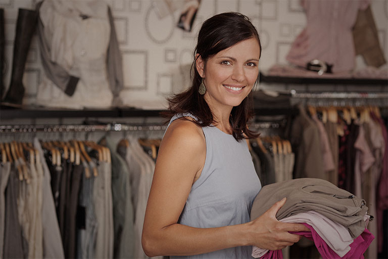 Woman is smiling in boutique